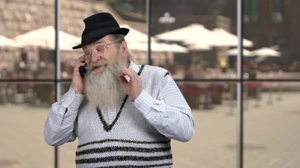Cheerful Senior Businessman Talking on Phone