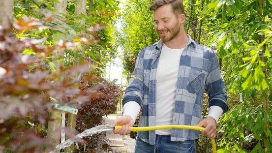 Thumbnail for Smiling Gardener with Hose