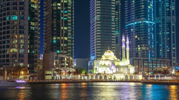 Cover Image for White Mosque Among Skyscrapers in the Harbor Area of Dubai Marina