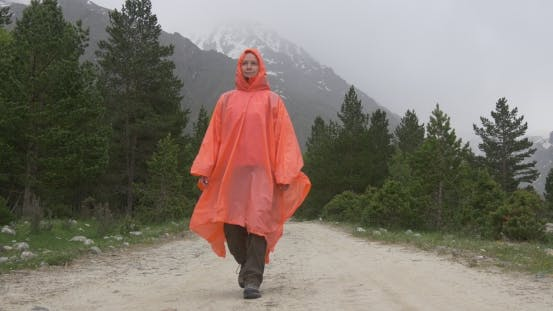 Thumbnail for Person Walking on Forest Road Under Rain