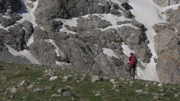 Thumbnail for Woman Walking on the Edge of Mountain Ridge