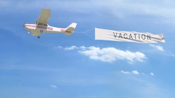 Thumbnail for Small Propeller Airplane Towing Banner with VACATION Caption in the Sky