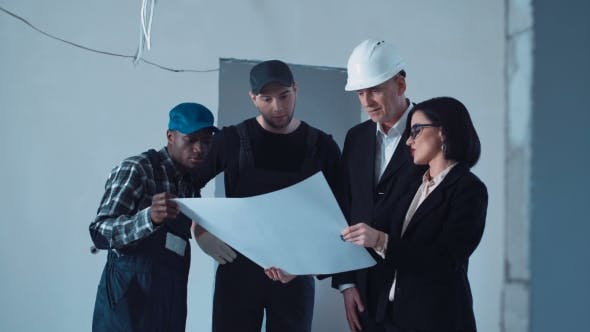 Thumbnail for The Building Team Discussing Blueprint