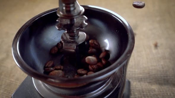 Thumbnail for Coffee Beans Fall in the Old Grinder