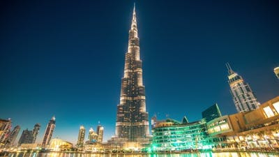 Dancing Fountain Near Burj Khalifa Illuminated By the City at Night. Burj Khalifa Is the Tallest