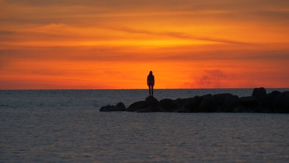 Thumbnail for Silhouette of Woman at Sunset at Sea