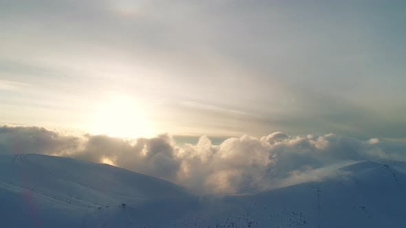 Thumbnail for Winterland, Fly Over Mountains in Evening Sunlight