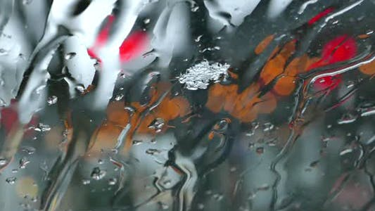Thumbnail for Snowing Flakes and Drops On Windshield Glass