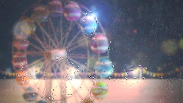 Thumbnail for Window View Of Ferris Wheel In The Rain