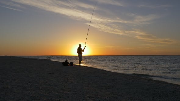Fisherman Throwing Fishing Tackles at Sunrise
