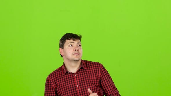 Thumbnail for Guy Looks Up and Selects the Option He Needs. Green Screen