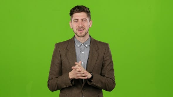 Thumbnail for Young Presenter in the Studio Tells the Weather Forecast Correctly. Green Screen
