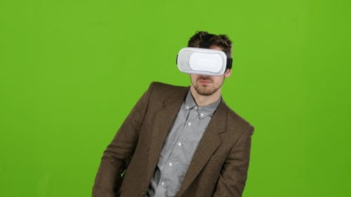 Man in the Glasses Is a Virtual Reality, Evades the Fictional Obstacles. Green Screen