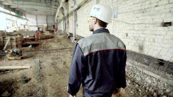 Thumbnail for Back View of Construction Worker. Anonymous Man in Hard Hat and Uniform