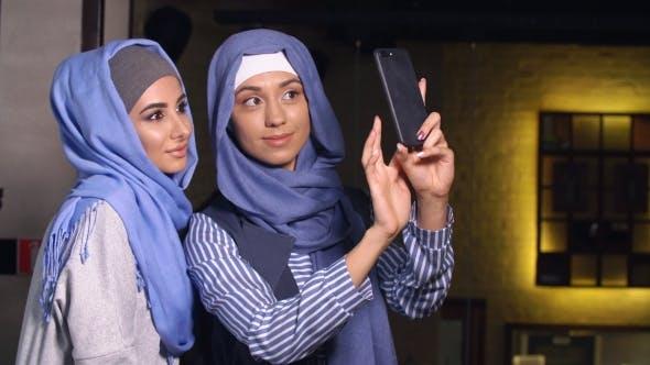 Thumbnail for Modern Muslim Women Talking and Smiling