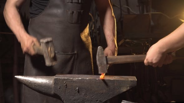Thumbnail for Blacksmith Forges on the Anvil. Brutal Man Working at the Forge with Metal. Blacksmith, Holds Molten
