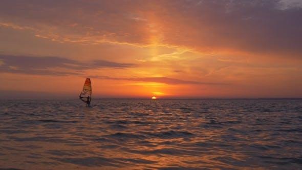 Windsurf Sailing at Great View of Sunrise