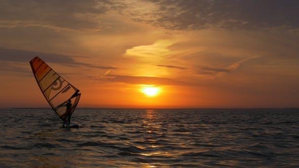 Thumbnail for Aquatics, Windsurfing in Sea at Sunset