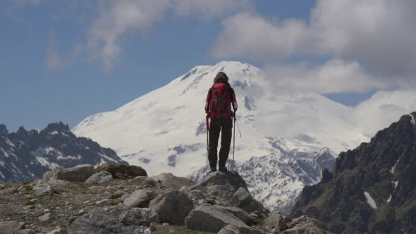 Thumbnail for Hiker Looking at Majestic View of High Mountains