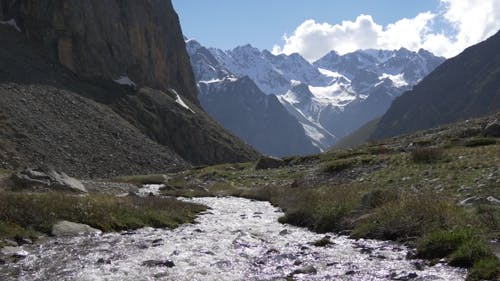 Mountain River with Glaring Water From Glacier