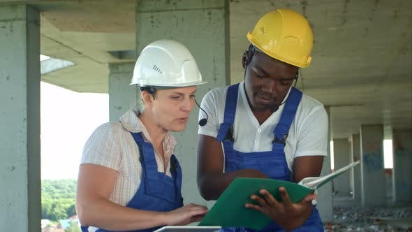 Thumbnail for Workers Working on Building Site with Tablet