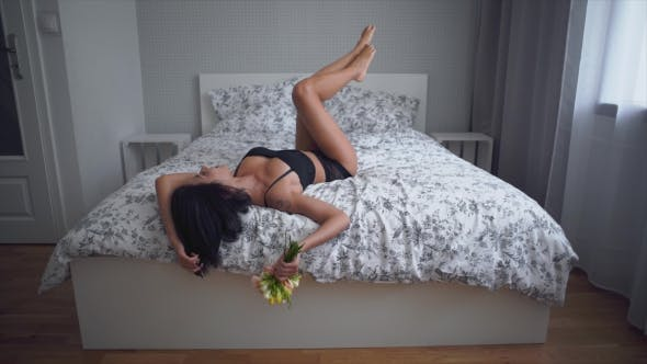 Thumbnail for Sexy Woman in a Black Lingerie Lying on Bed