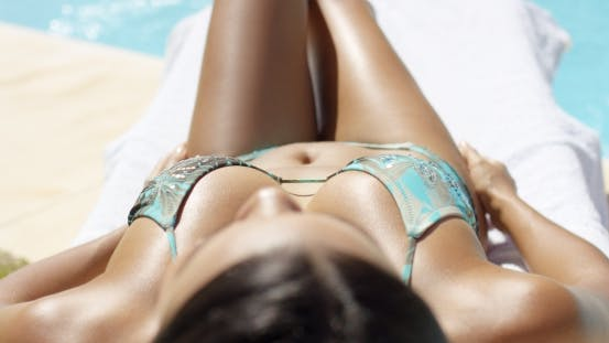 Thumbnail for on the Cleavage of a Woman Sun Tanning