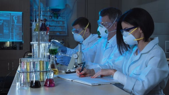Thumbnail for Group of Chemists Working in a Laboratory