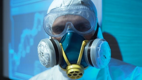 Thumbnail for Person Wearing a Biohazard Suit and Mask