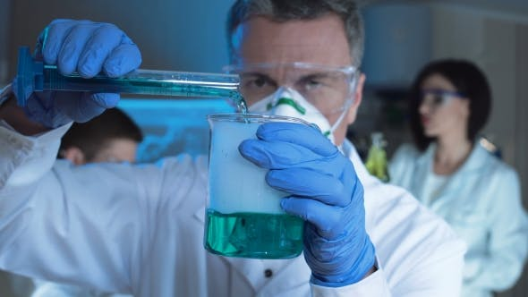 Thumbnail for Man Conducting Chemical Reaction