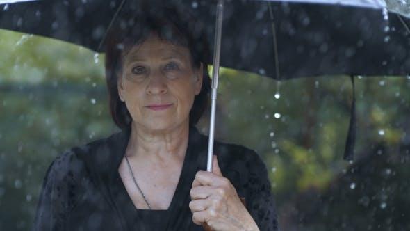 Thumbnail for Woman at Black Clothes Under Umbrella at Rain