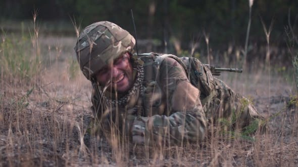 Soldier Crawling in Field