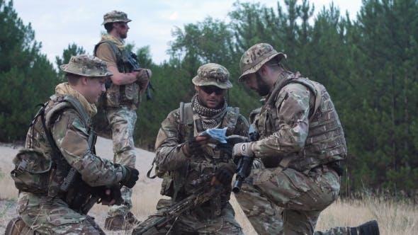 Military People Navigating on Battlefield