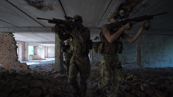 Men with Guns Entering Abandoned Building