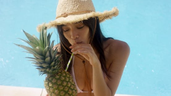 Thumbnail for Young Woman Sipping a Pineapple Cocktail