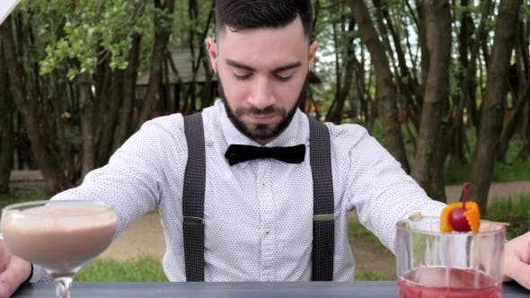 Thumbnail for Bartender Behind Bar on Background Park, Barkeeper , Barmen Submit Alcohol, Colored Chilled Drinks