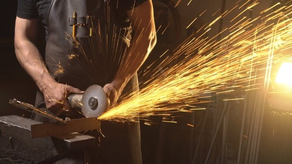 Thumbnail for Sparks During Cutting of Metal Angle Grinder. Worker Using Industrial Grinder.