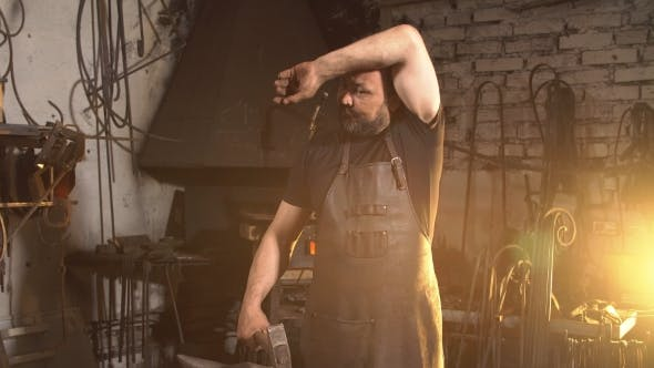 Thumbnail for Brutal Blacksmith Wipes Sweat From Face