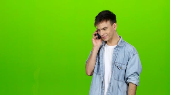 Thumbnail for Guy Is Flirting with His Girlfriend on the Phone. Green Screen