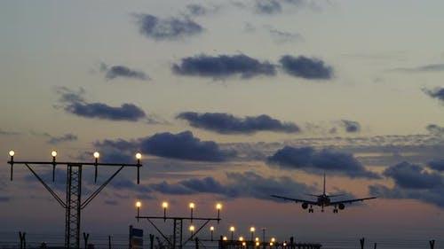 Airplane Commercial Jet Landing Sunset