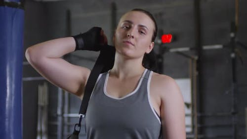 Young Confident Female Athlete Posing for Camera in Gym