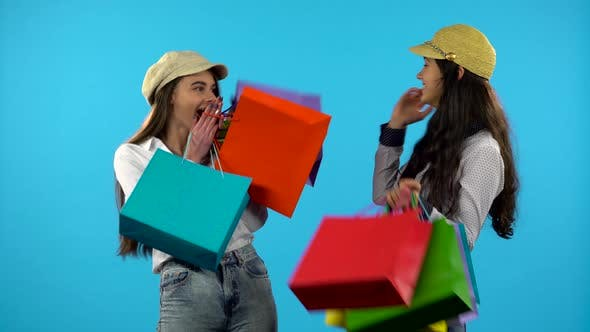 Thumbnail for Two Happy Smiling Girl Hold Shopping Bag. Blue Background