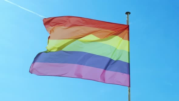 Thumbnail for Big Rainbow Flag Gay Pride LGBTQ Developing By the Wind Against the Blue Sky