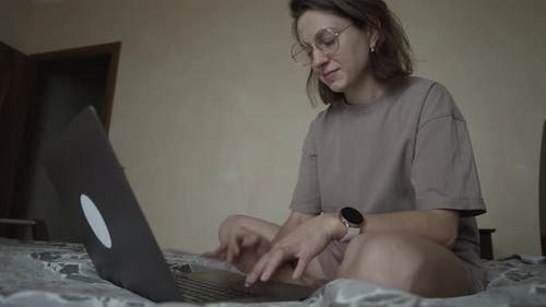 Freelancer Girl with Computer at Home