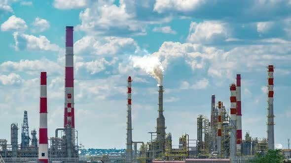 Working Process of the Oil Refinery Industry Plant with Cloudy Sky