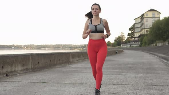Thumbnail for Sports Girl Jogging in the Waterfront Area