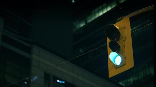 Traffic Light Works Against Background Skyscrapers Night
