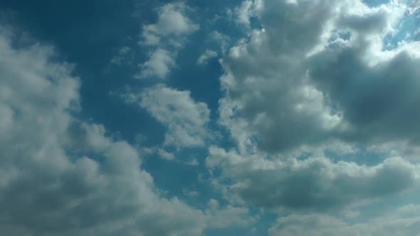 Sun Lights And Summer Rain Cumulus Puffy Clouds On Sky