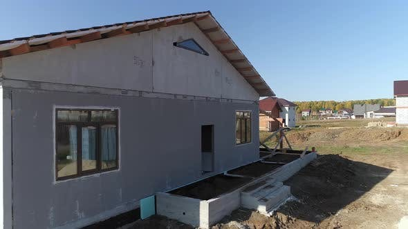 Thumbnail for Drone view of facade of house of panels. 15