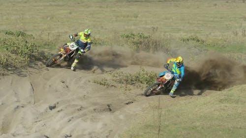 Riders on motocrosses